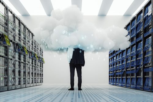 Man standing in a server room with cloud computing
